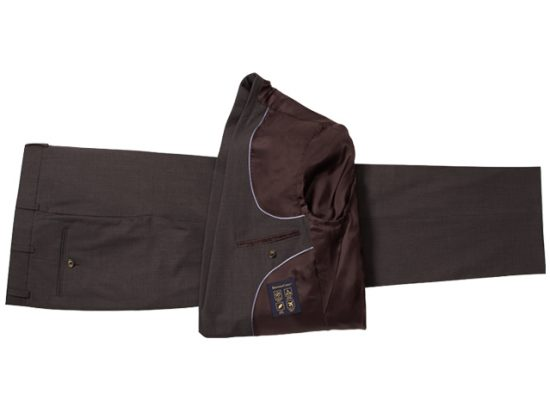 Fold suit jacketin half horizontally and lay it on top of your dress pants, which should be laid out flat along their front and back pleats