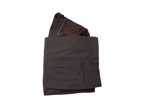 Fold the pants into thirds by pulling the bottoms and then the waist over the jacket to form a bundle
