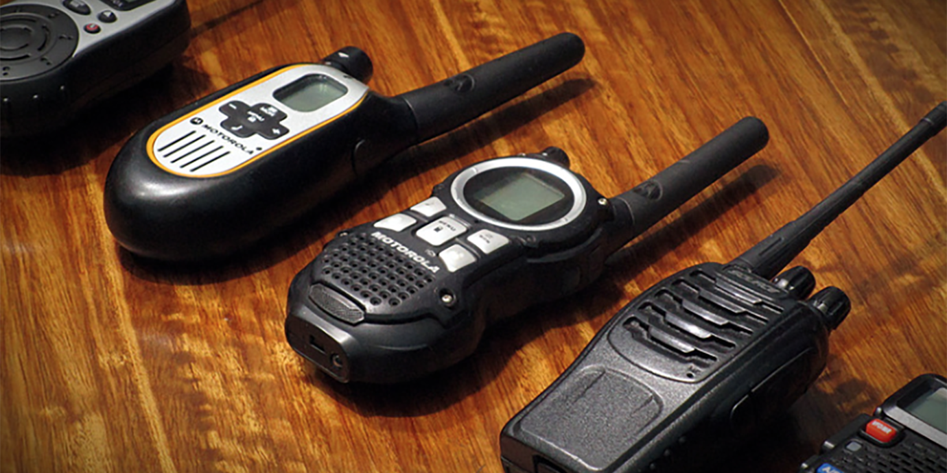 Array of walkie talkies on a table