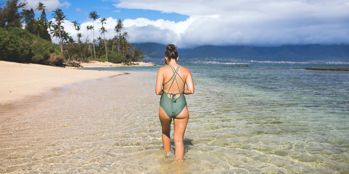 Hawaii Beach Woman in Water - Sunscreens Allowed in Hawaii