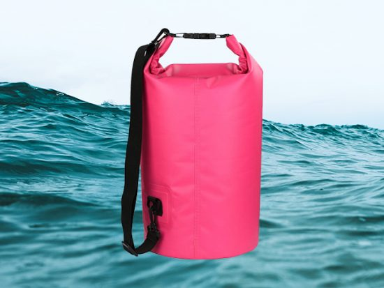 hot pink dry bag with ocean