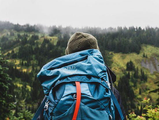 Backpacker navigating through mountain