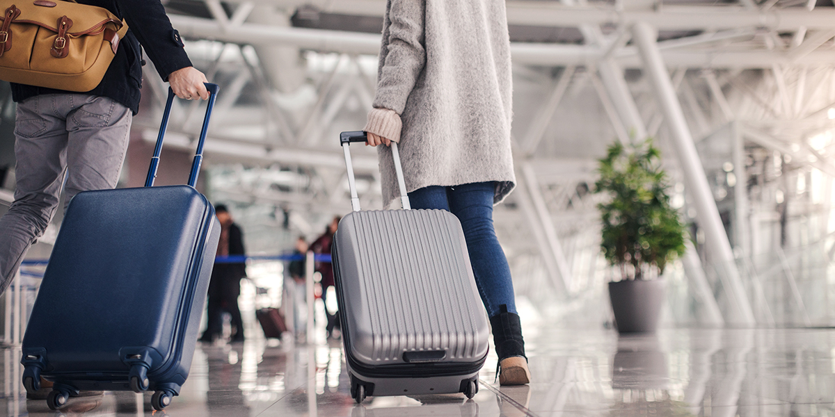 Perfect Luggage - Airport Couple Walking with Suitcases