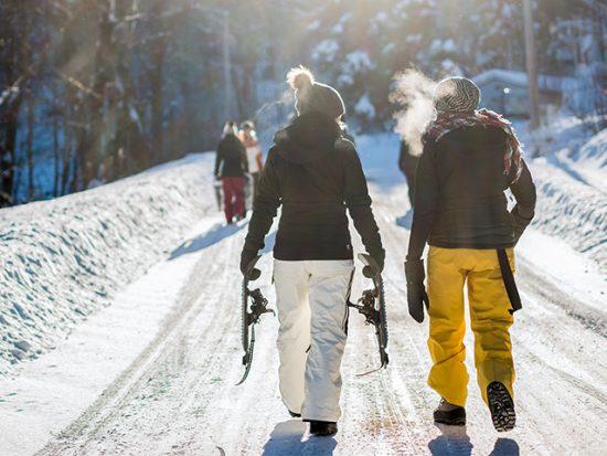 Two Women Walking in Snow