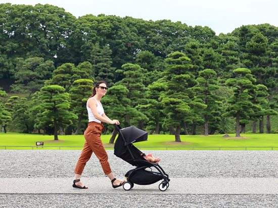 Traveling with Strollers - Woman pushing stroller
