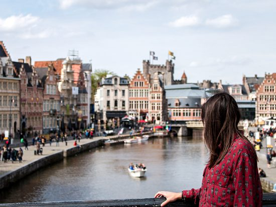 Woman in Amsterdam, looking at canal