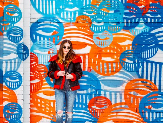 Woman in front of a Mural in Denver