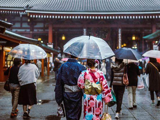 Couple Walking in the rain at Sensō-ji temple in Tokyo, Japan