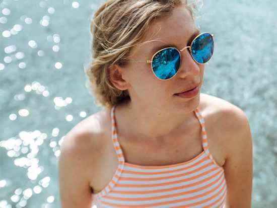 Girl Wearing Sunglasses at the Beach.