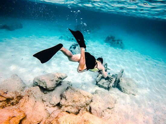 Man snorkeling with camera.