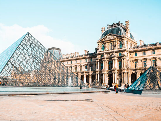 The Louvre Museum on a sunny day in Paris.