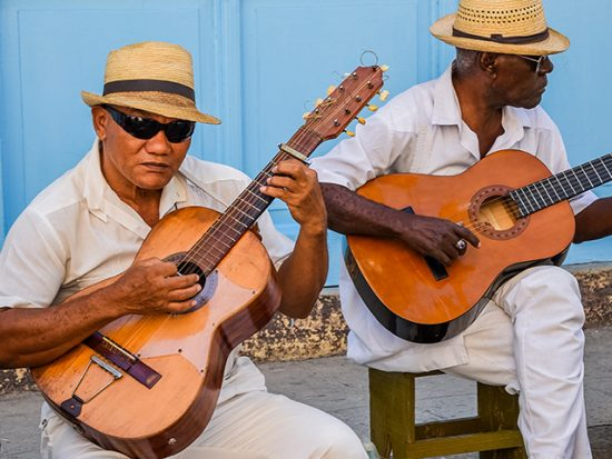 Two men playing guitar in Havana Cuba.