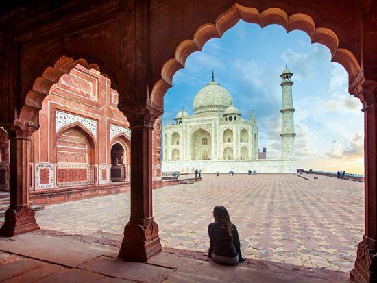 Woman Sitting and Looking at the Taj Mahal.