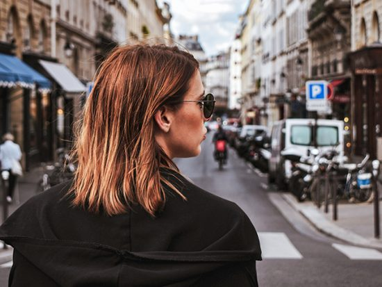 Woman standing on the street in paris.