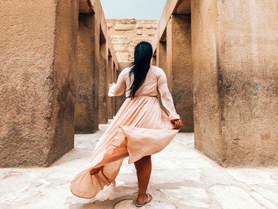 Woman walking through the streets of Cairo.
