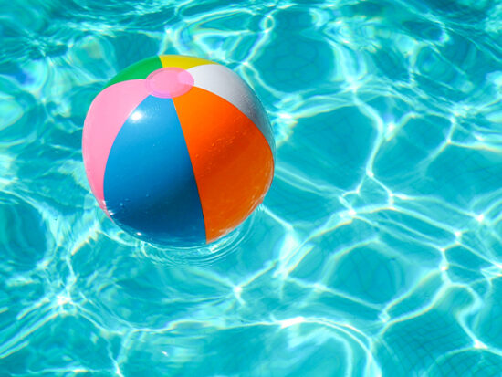 Beach ball floating in a pool.