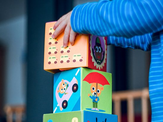Child building with blocks.