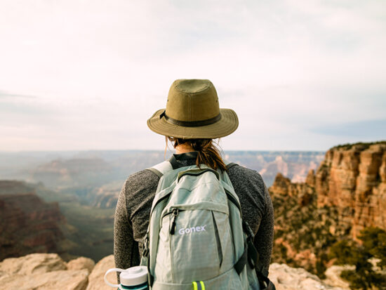 Woman looking out over the Grand Canyon.