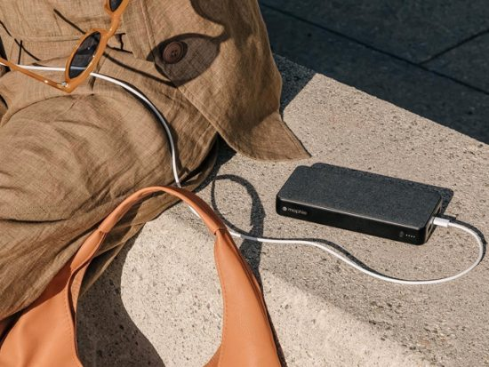Woman sitting outside with a mophie charger.