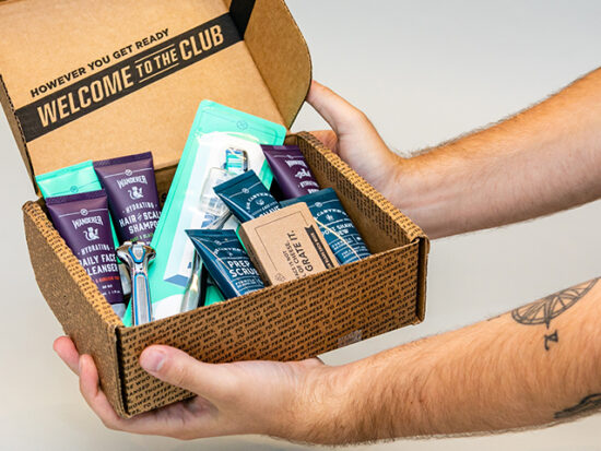 Dollar Shave Club Starter Set Box being held up.