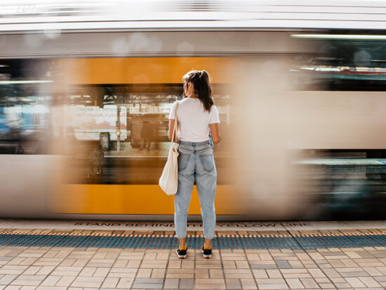 Woman standing on a platform waiting for the train.