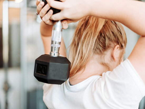 Woman working out with a weight.