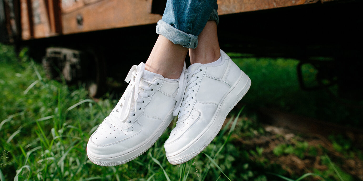 Close-up of woman's white sneakers.
