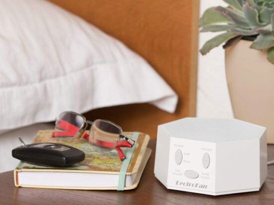 LectroFan High Fidelity White Noise Machine on Bedside Table.