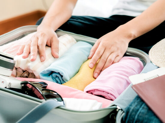 Woman packing a suitcase.