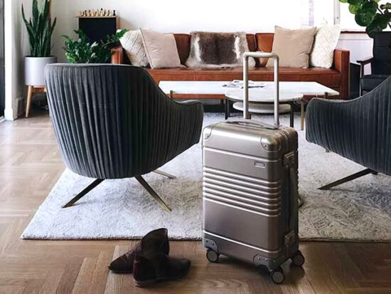 Arlo Skye Aluminum Carry-on in living room.