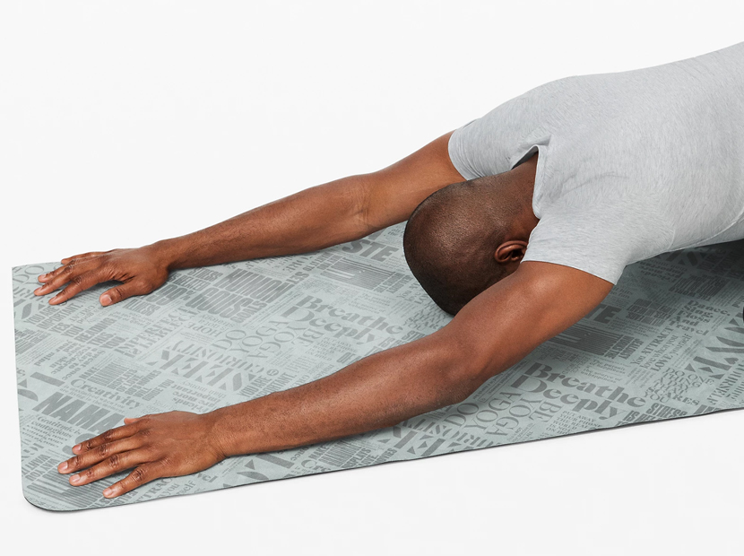 Man practicing yoga on a Lululemon Carry Onwards Mat.