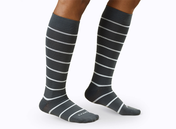 Companion Compression Socks grey with white stripes.