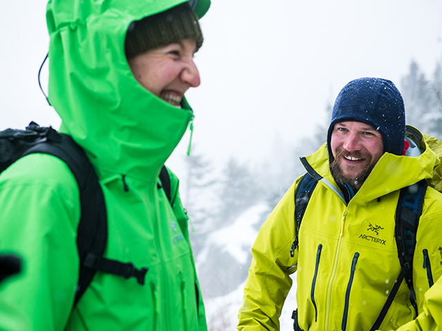 Two people standing in the snow wearing Arcteryx.