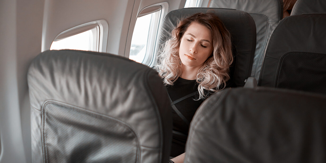 How to Sleep On a Plane (For Real): Tips for Snoozing at 30,000 Feet.