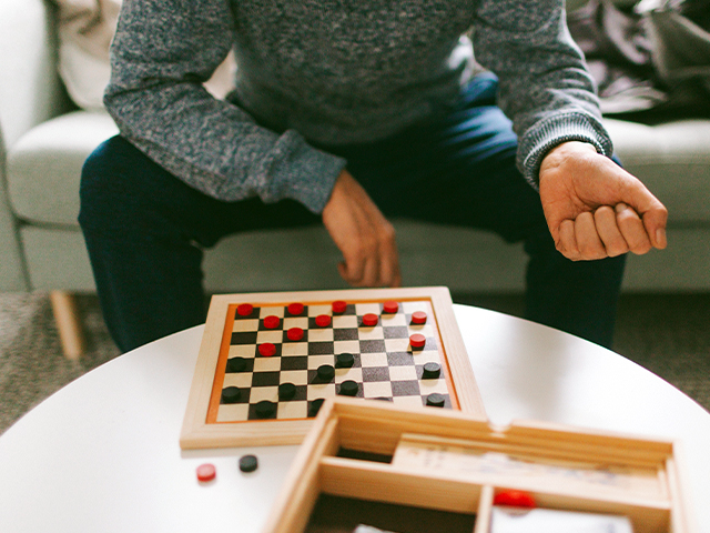 Man playing checkers.